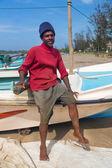 Portrait of local fisherman sitting on boat — Foto de Stock