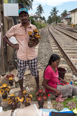 Local street vendor couple selling things by the railroad. — Stock Photo
