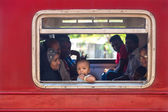 Local people in the train looking through window — Stockfoto