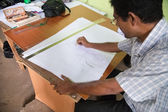 Local man drawing design for clothes — Photo