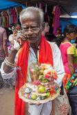 Local street vendor selling religious souvenirs. — Foto de Stock