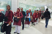Passengers wait in check-in line at Doha International Airport — Stock Photo