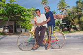 Local men riding a bicycle — Stock Photo