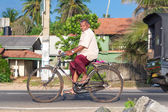 Local man riding a bicycle — Stock Photo