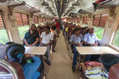 Commuters sitting in train to Colombo — Stockfoto