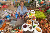 Local street vendor selling vegetables — Stock Photo