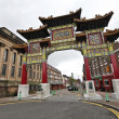 At Chinatown Gate, Nelson Street, Liverpool, England - Stock Photo