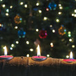 A Trio of Christmas Candles in an Aspen Log — Stock Photo