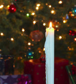 A White Christmas Candle with Blurred Lights — Photo