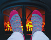 A Pair of Feet and a Cozy Fire — Stock Photo