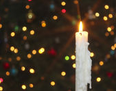 A White Christmas Candle with Blurred Lights — Stock Photo