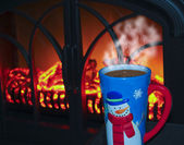A Snowman Mug of Cocoa by the Fire — Stock Photo