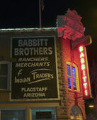 A Babbitt Brothers Neon Sign at Night — Stock Photo