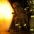 Firefighters attack a propane fire during a training exercise. — Stock Photo