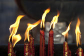 Candles in chinese temple — Stock Photo