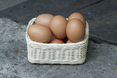 Eggs on basket — Stock Photo