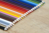A lot of wooden pencils on wood — Stock Photo
