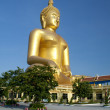 Big Golden Buddha statue in Thailand temple — Stock Photo #32022901
