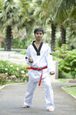 Asian man playing with taekwondo — Stock Photo