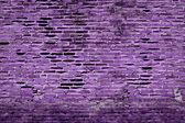 Purple rough grunge brick wall background — Stock Photo