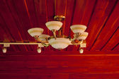 Vintage ceiling lamp fixture in dark hallway — Stock Photo