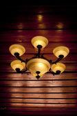 Vintage ceiling lamp fixture in dark hallway — Stock Photo