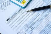 U S Tax form, pen and calculator — Stock Photo