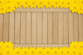 Yellow flowers frame wood background — Stock Photo