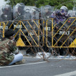 Police Commandos guard a barricade on Makkhawan Bridge outside Government — Stock Photo