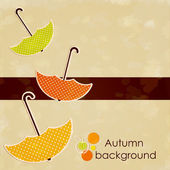 Autumn background with colored umbrellas — Stock Vector