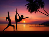 Silhouette of Yoga woman in sunset — Stock Photo