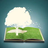 Paper cut of tree on grass book — Stock Photo