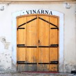 Shabby wooden door of an old Prague wine-house — Stock Photo