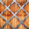Wooden door with wrought pattern — Stock Photo