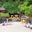 Praying at holy cave temple Pura Lawah — Stock Photo