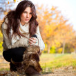 Beautiful woman enjoying in the autumn park — Stock Photo