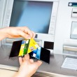 Cash withdrawal with Visa card — Stock Photo
