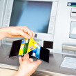 Cash withdrawal with Visa card - Stock Photo