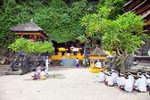 Praying at holy cave temple Pura Lawah — Stock Photo