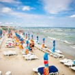 Crowded beach with tourists  in Mamaia, Romania. - Stock Photo