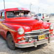Red Plym Outh oldtimer car, Havana, Cuba - Stock Photo