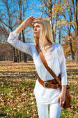 Woman looks askance at the autumn colored park — Stock Photo
