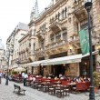Постер, плакат: Tourists visit Old Town in Bucharest Romania