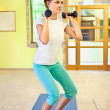 Happy young woman doing fitness at home. — Stock Photo