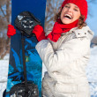 Beautiful young snowboarder in winter clothes with snowboard — Stock Photo