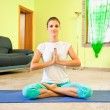 Stock Photo: Young beautiful woman preparing for meditation