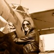 Portrait of female pilot  with plane propeller - Stock Photo