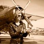 Portrait of beautiful female pilot — Stock Photo