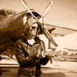 Portrait of beautiful female pilot - Stock Photo