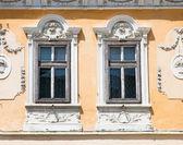 Two windows on orange wall . Sibiu, Romania — Stock Photo